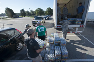 U.S. Soldiers with the 742nd Maintenance Company, South Carolina Army National Guard, work alongside local law enforcement, the State Guard and volunteers, to distribute drinking water to residents affected by  the South Carolina flood at the Lower Richland High School, Columbia, S.C., Oct. 6, 2015. The South Carolina National Guard has been activated to support state and county emergency management agencies and local first responders as historic flooding impacts counties statewide. Currently, more than 1,100 South Carolina National Guard members have been activated in response to the floods. (U.S. Air National Guard photo by Tech. Sgt. Jorge Intriago/Released)